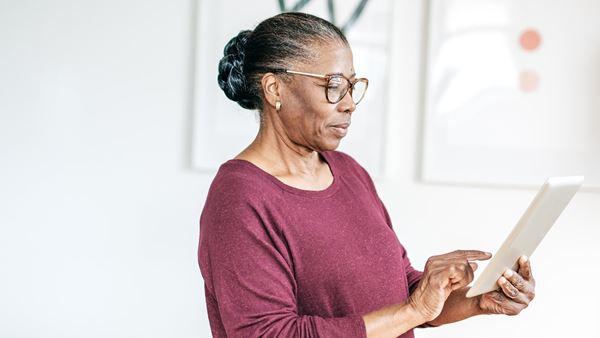 Woman using iPad tablet